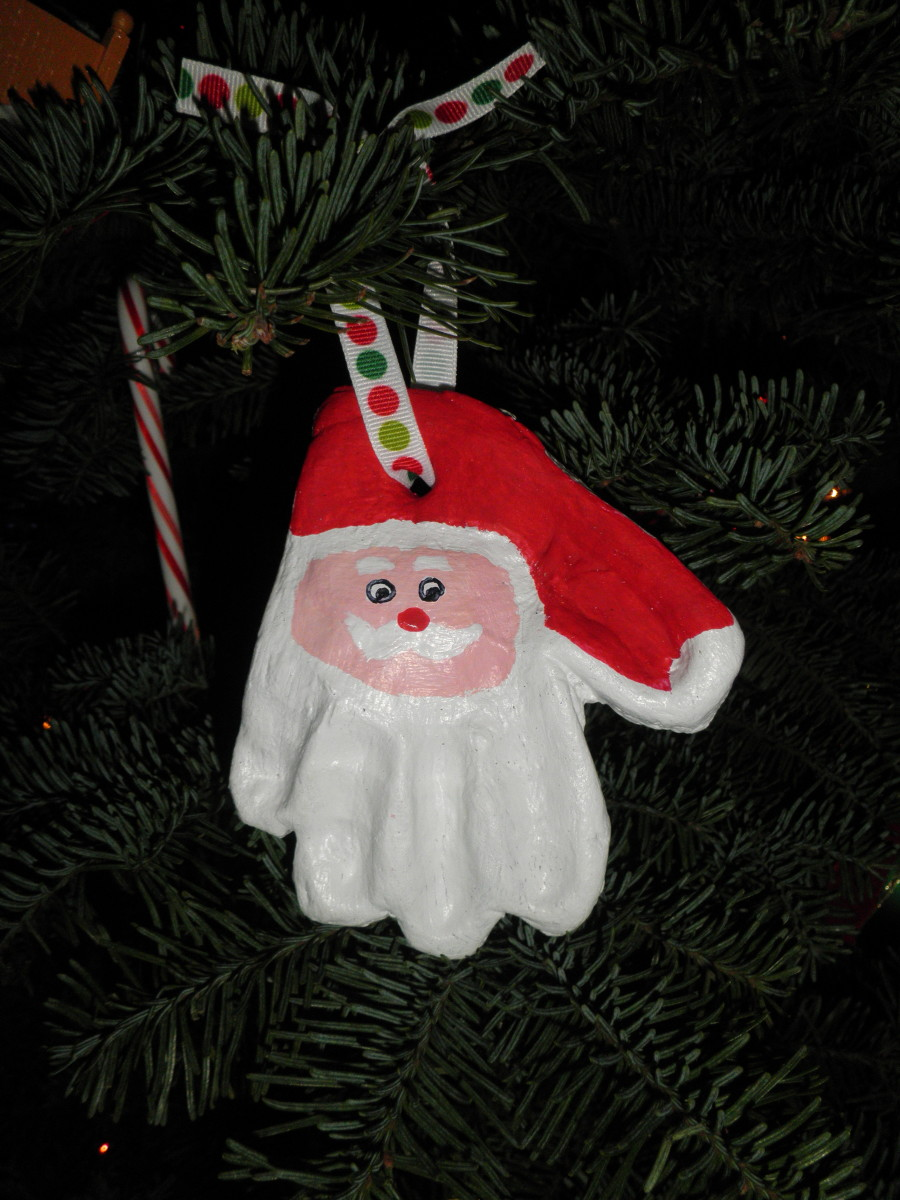 A Santa ornament made from a childs hand-print, Made from the easy to make salt clay dough recipe, just flour, warm water and salt.