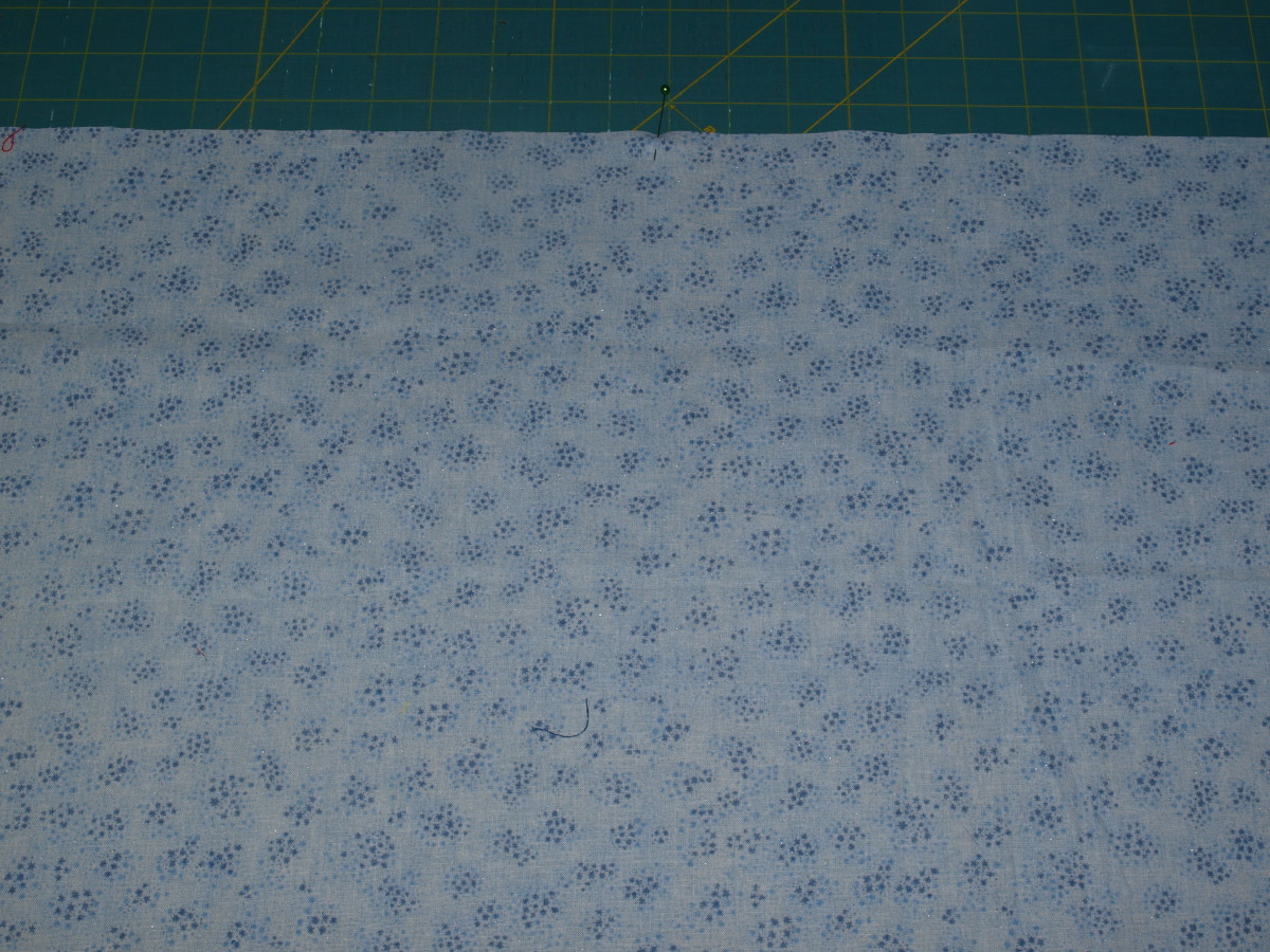 The backing fabric cut to desired size, with wrong side facing up.