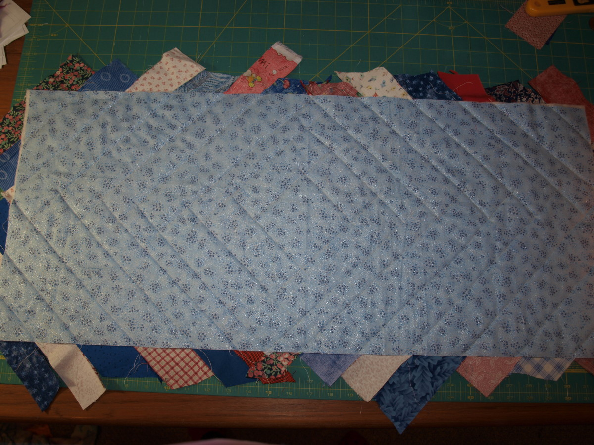 Flip the runner over and get ready to trim to size.  Note the quilting design on the back of the table runner.