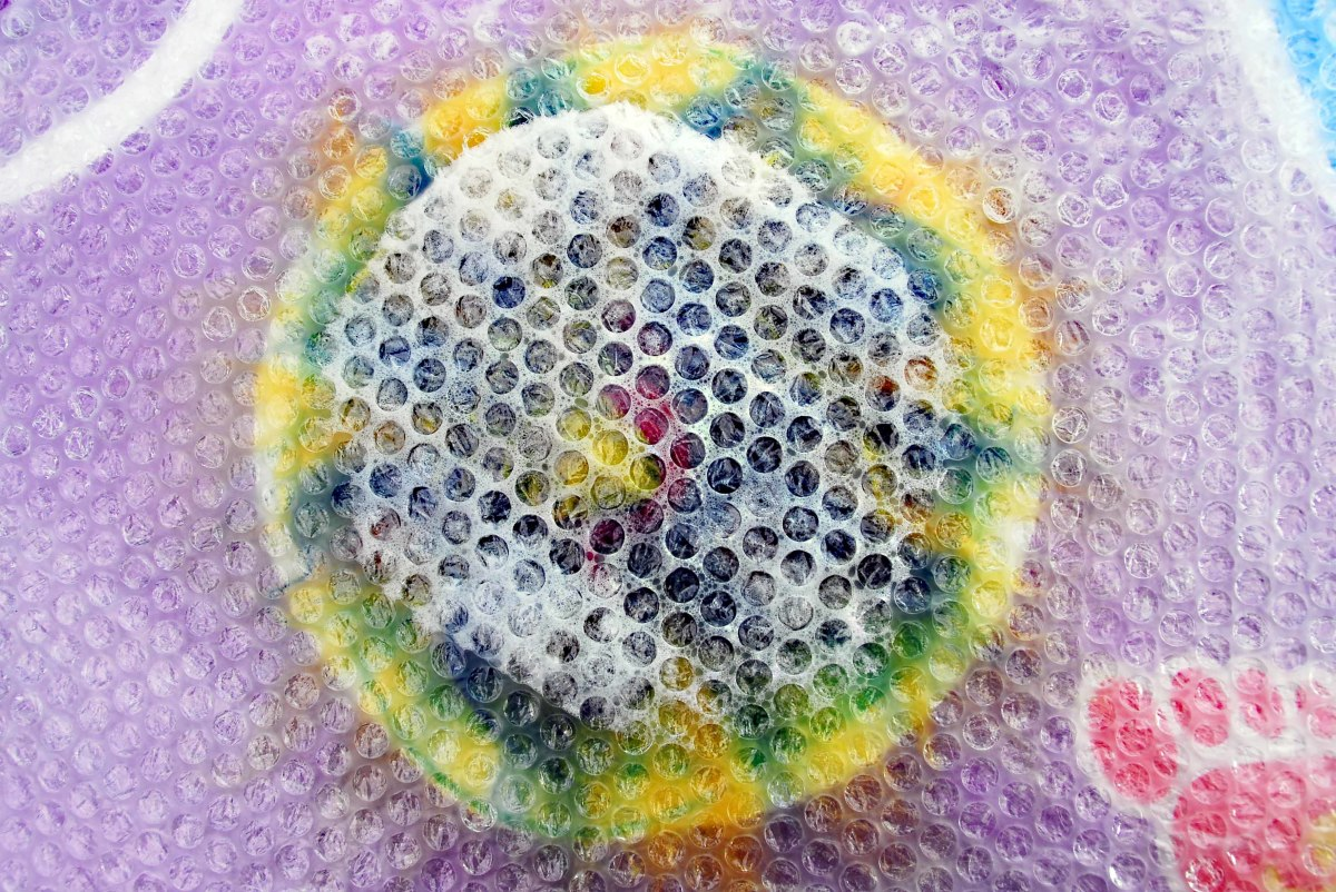 Start to disperse the water down and outward with the bubble wrap.