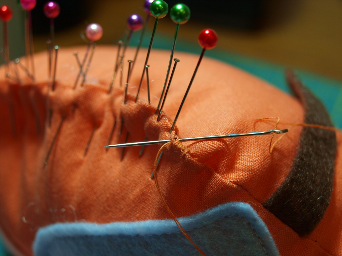 3. Using a matching thread color, whip stitch tightly along the edge, removing pins as needed.