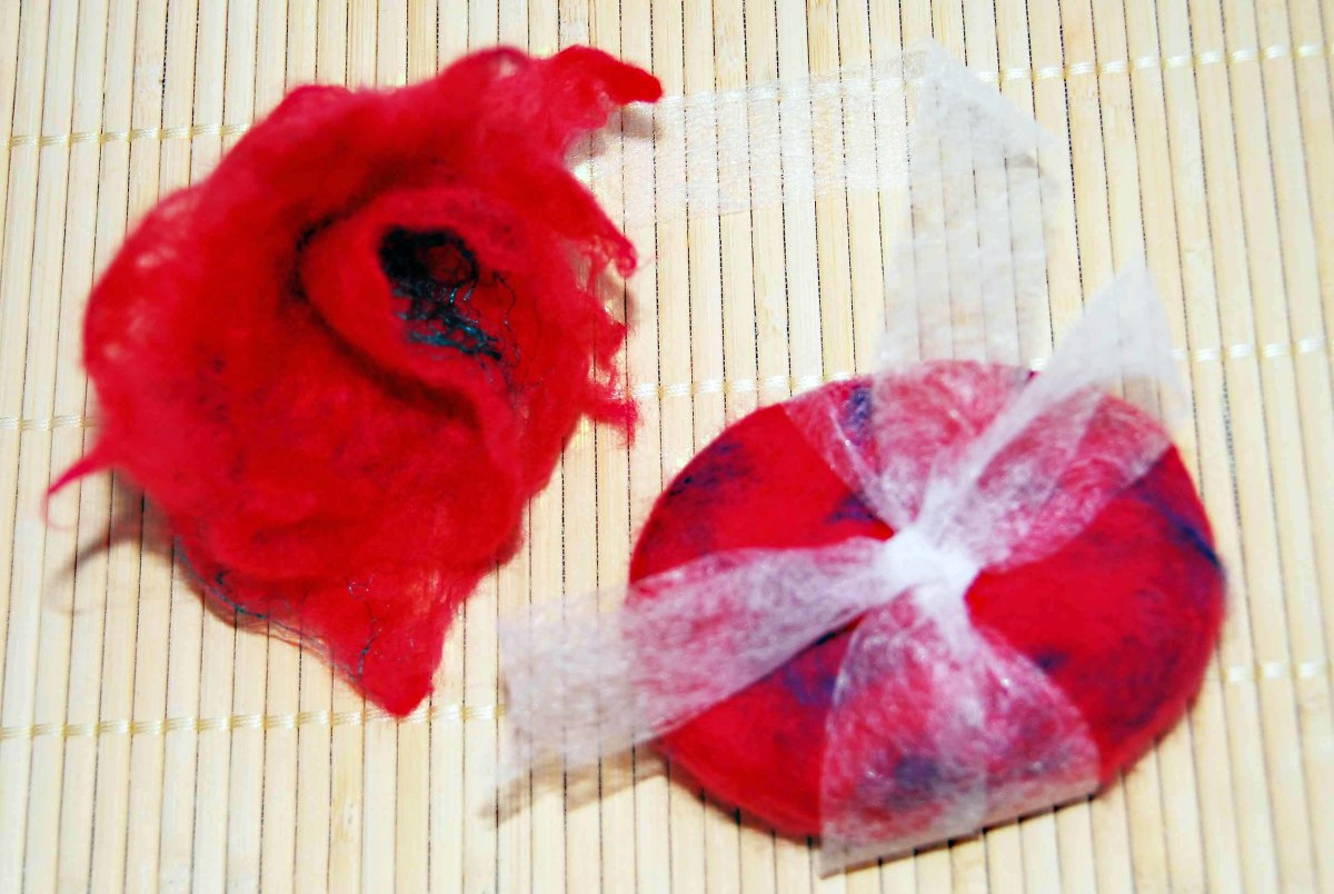Tie dried soap with a bow and add a felted flower hair clip to the top of your little gift box