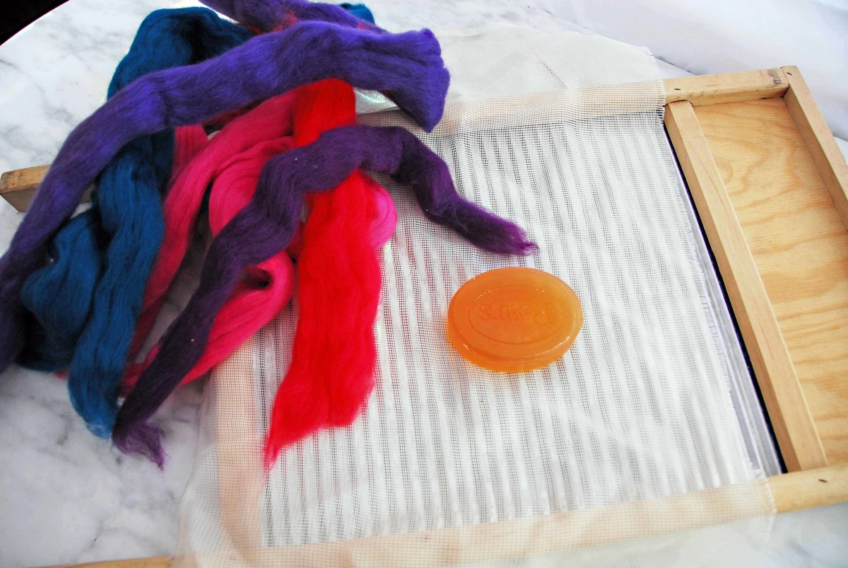 Soap, netting, wash board and merino dyed wool tops