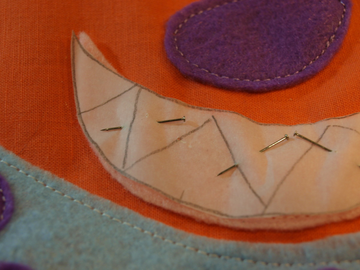 Preparing to add decorative stitching for teeth.