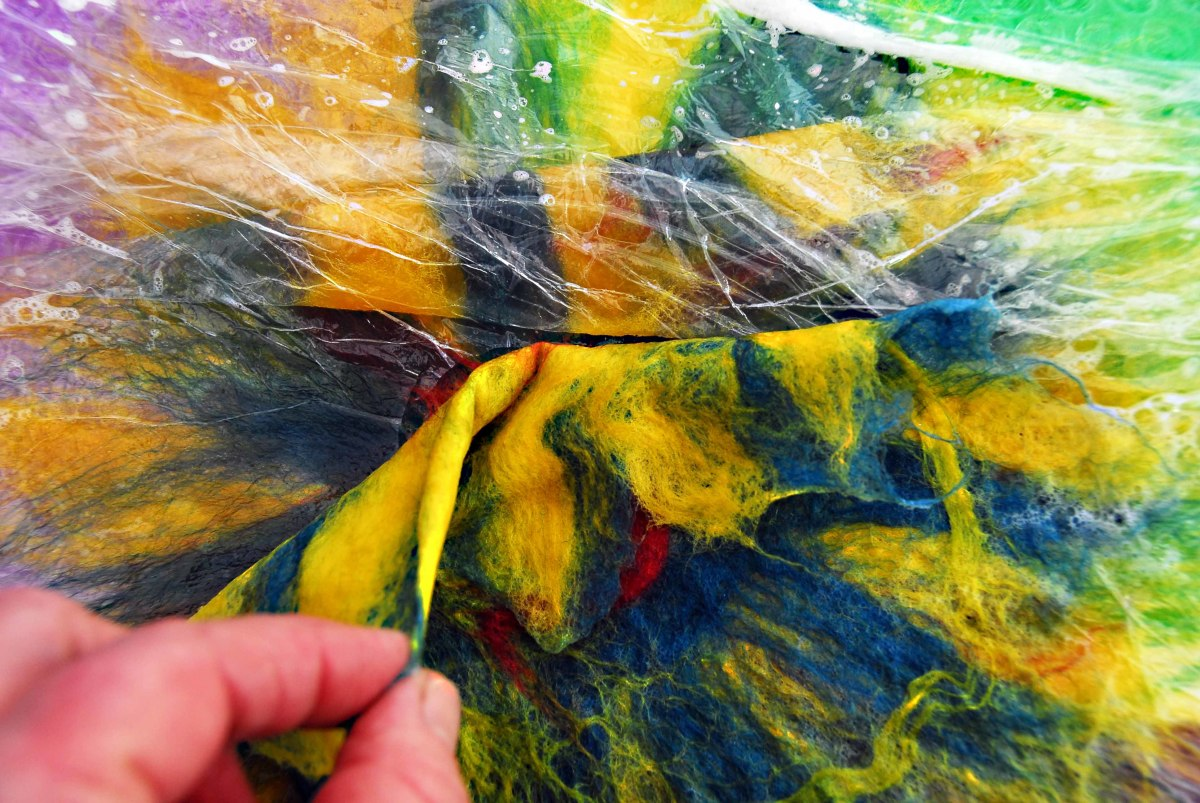 Removing the layers of plastic wrap  - one by one!