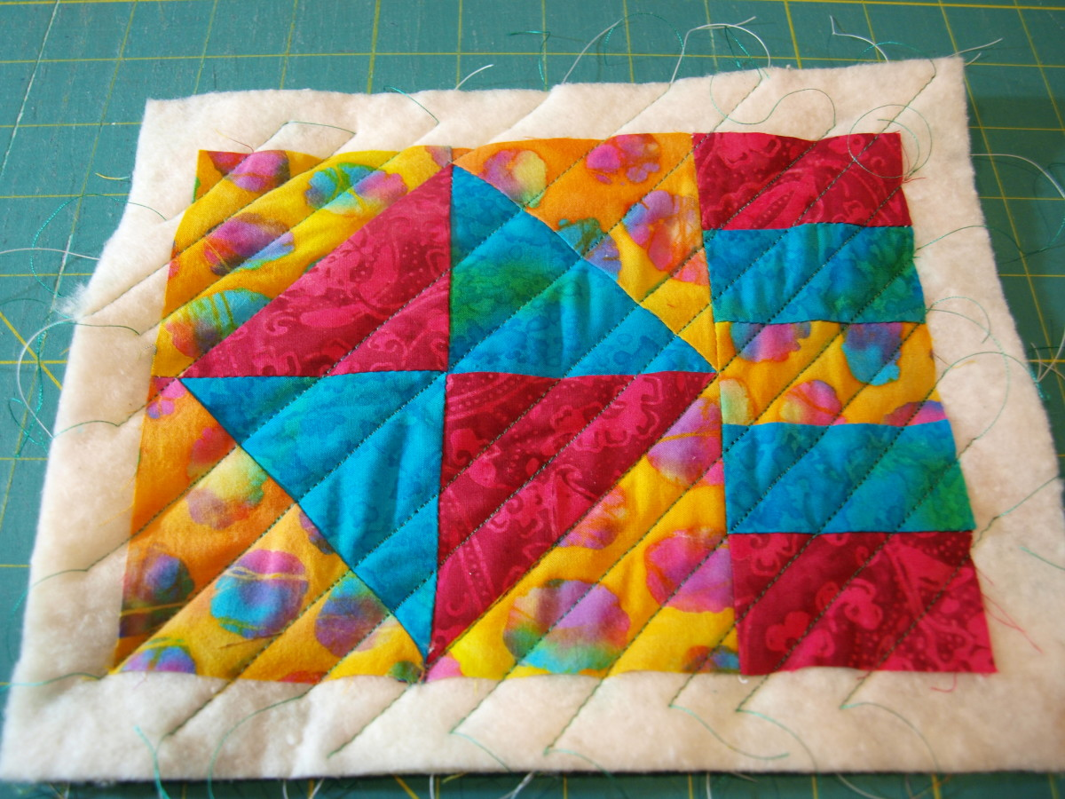 This mug rug is quilted using diagonal lines marked on the quilt.