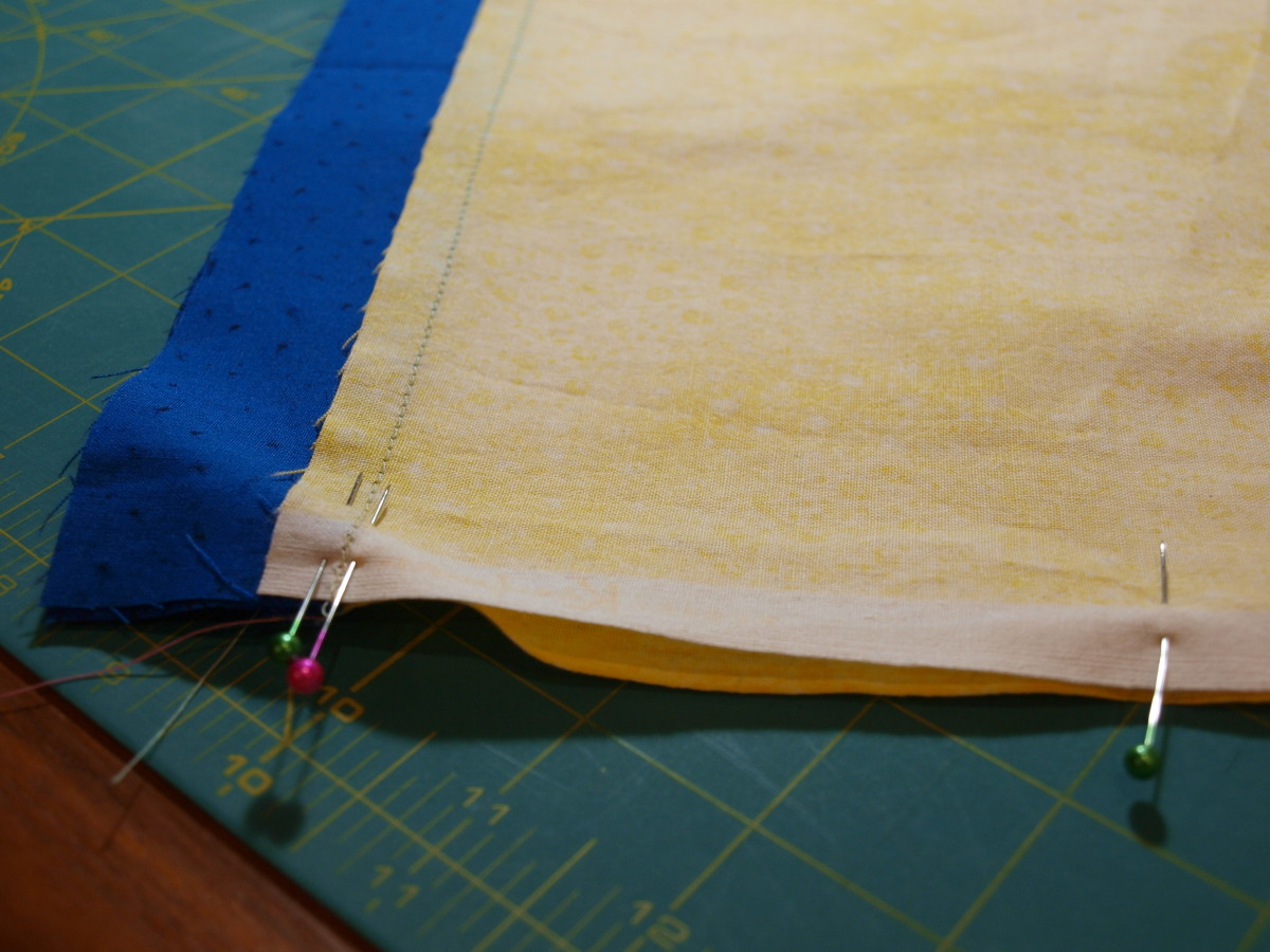 1. Fold the short sides of the border strip together (right sides facing each other) and pin.  It will form a loop.