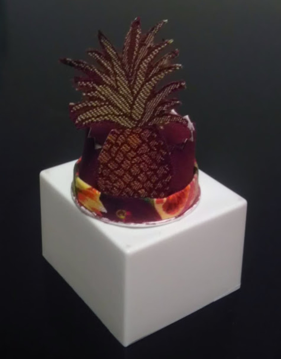 K-cup Barbie hat with pineapple. Philip Treacy, eat your heart out!
