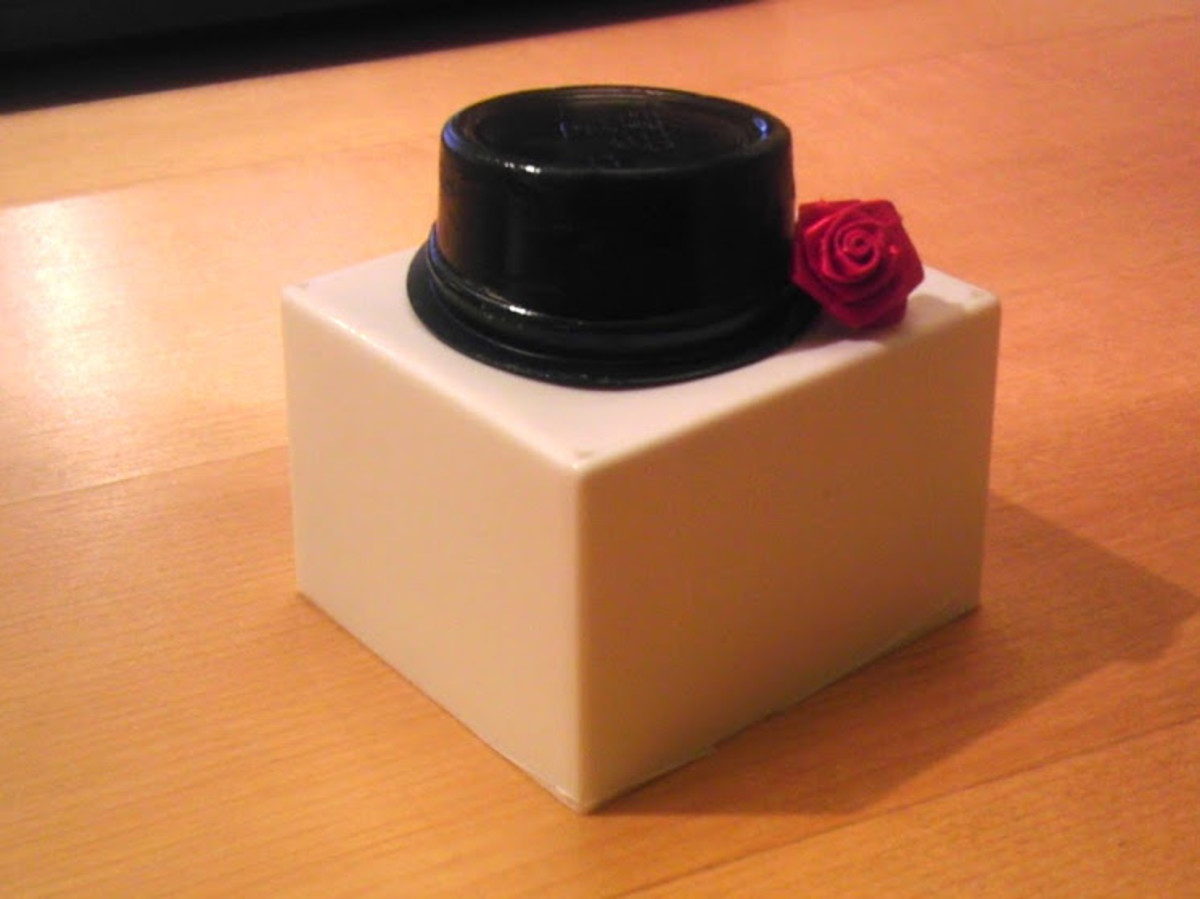 This black top hat is suitable for either Barbie or Ken!