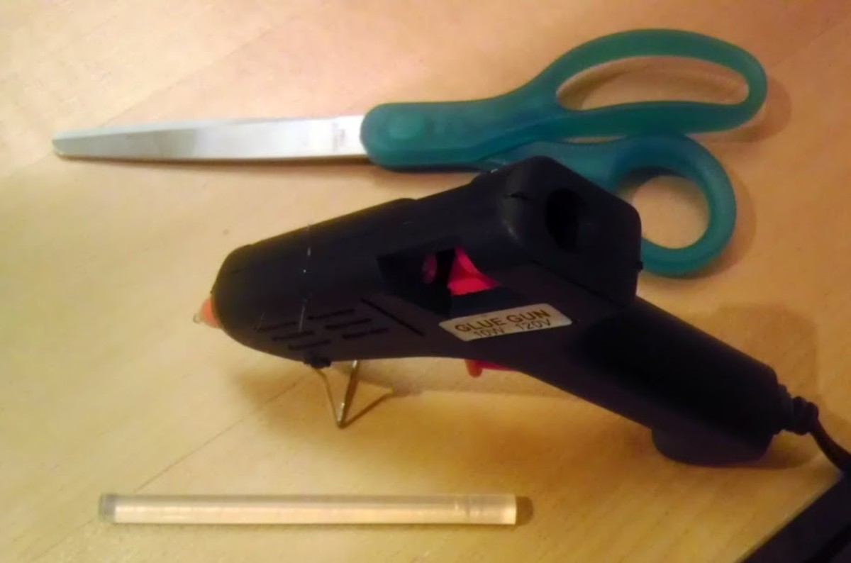 Sharp scissors (smaller is better) and a glue gun are needed