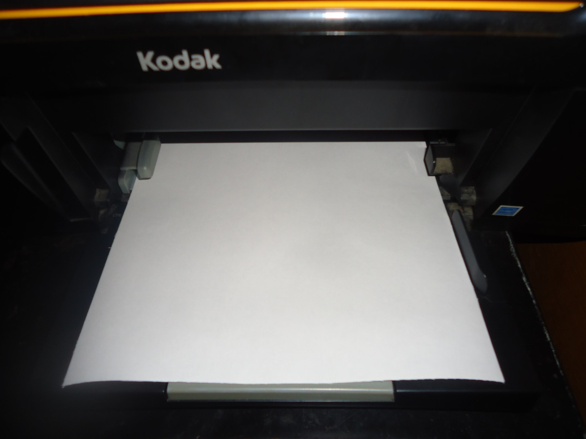 Place fabric sheet in your printer. I place mine in the feeding tray with the fabric side down. Each printer is different so make sure you are placing your fabric sheet properly so it will print on the fabric side.