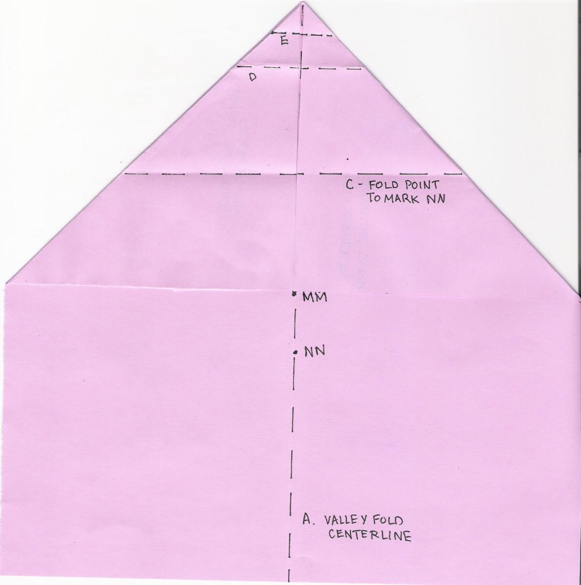 C. Fold point to mark NN