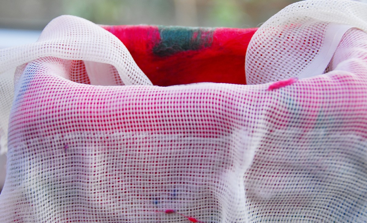 Use hot soapy water and curtain netting to flatten the fibers