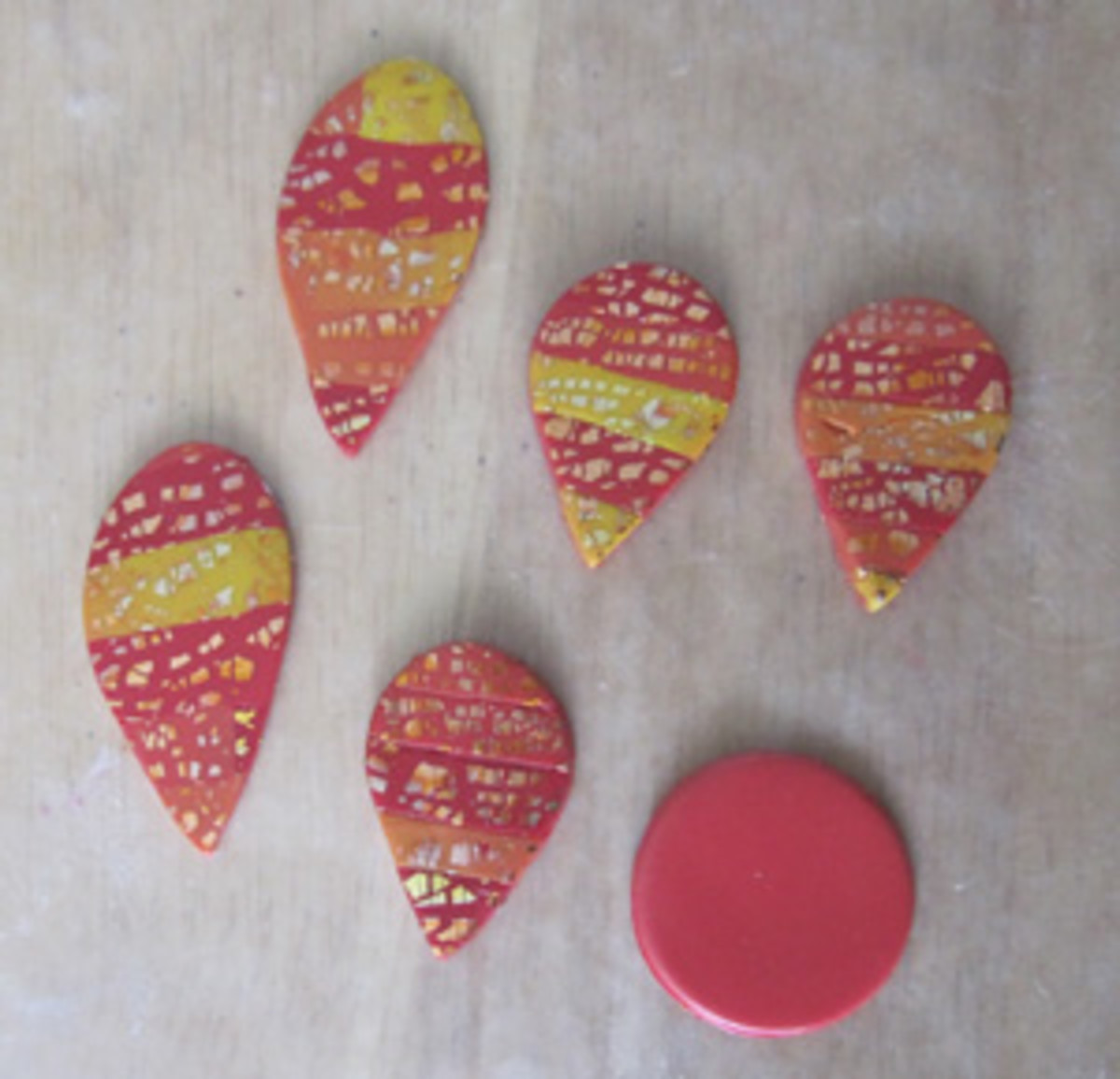 Cut out the polymer clay flower petals with a teardrop shaped clay cutter and elongate the petals, if desired.