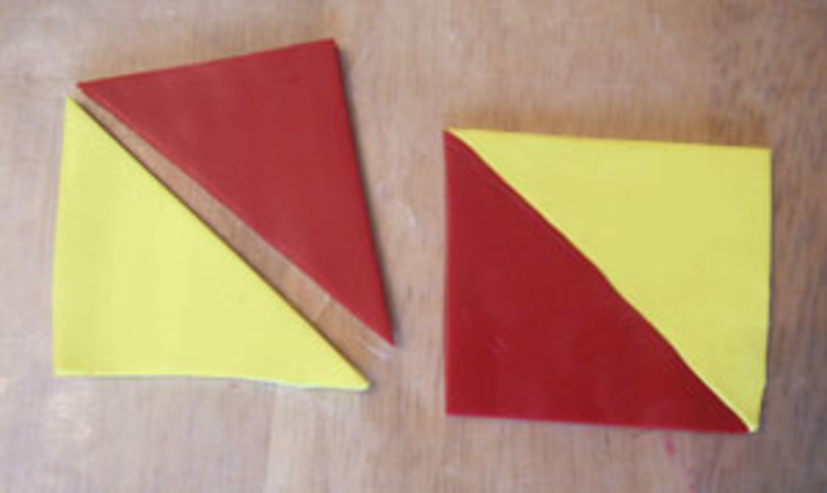 Cut the polymer clay sheets into squares and then triangles for the modified Skinner blend.