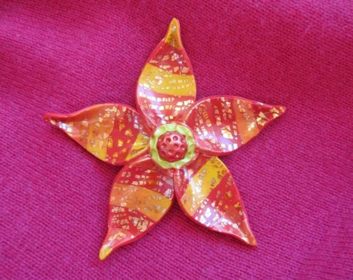 My polymer clay fantasy flower, baked, glazed and ready to attach to a brooch/pin jewelry finding