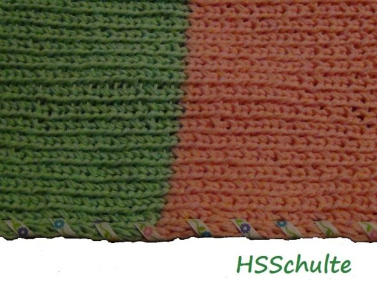 Knifty Knitter pink and green baby blanket.