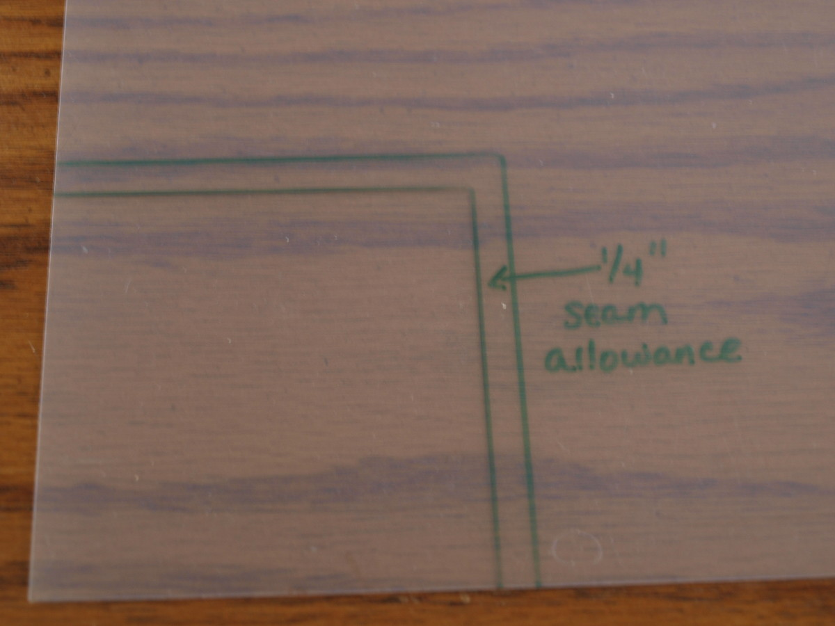 "Photo 2 - Add a 1/4"" seam allowance around the shape."