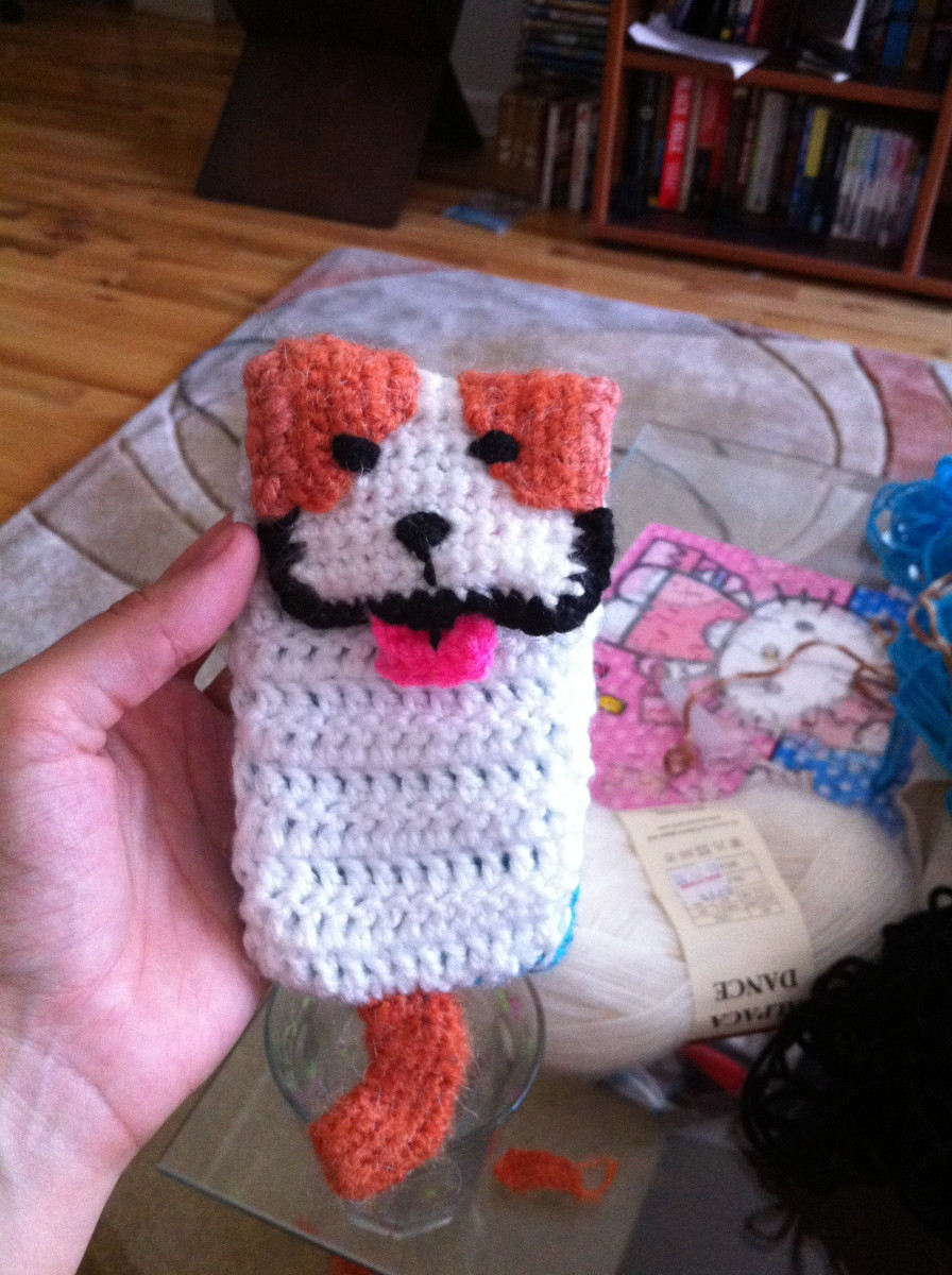 Embroidered face and added crocheted tail.