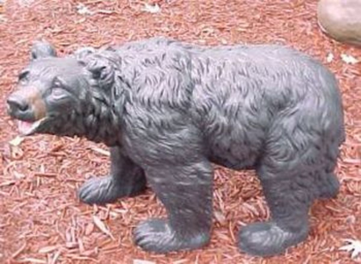 This painted bear looks great in a yard!