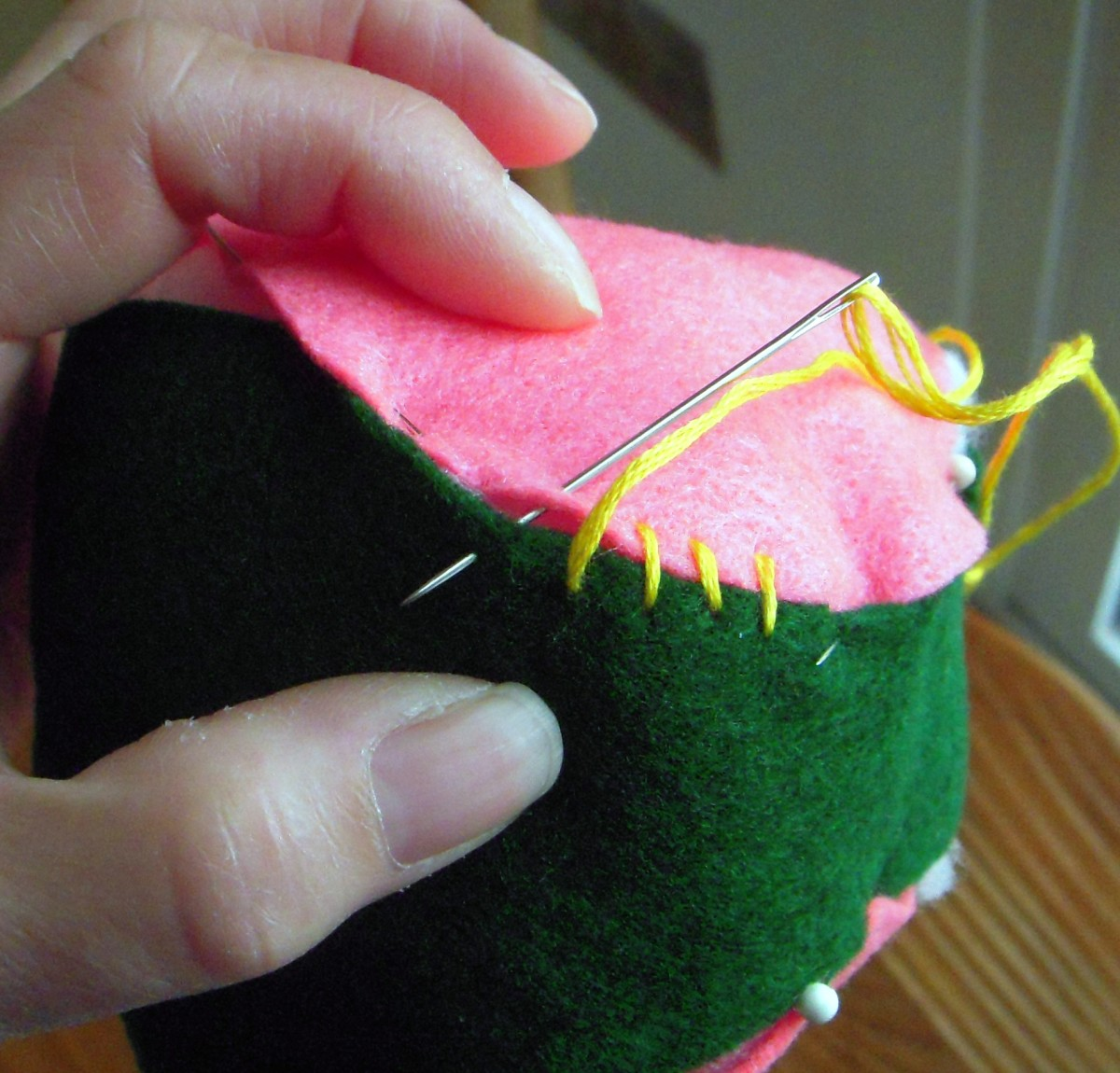 Butt together edges and sew with overhand stitch all the way around. Remove pins as you stitch.