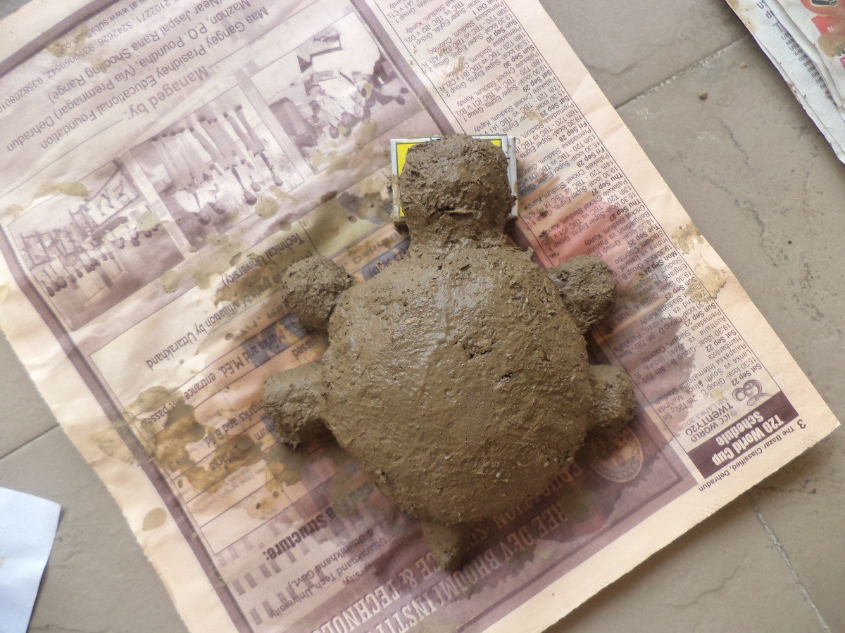 The tortoise paperweight drying on a piece of waste paper to prevent sticking to surfaces