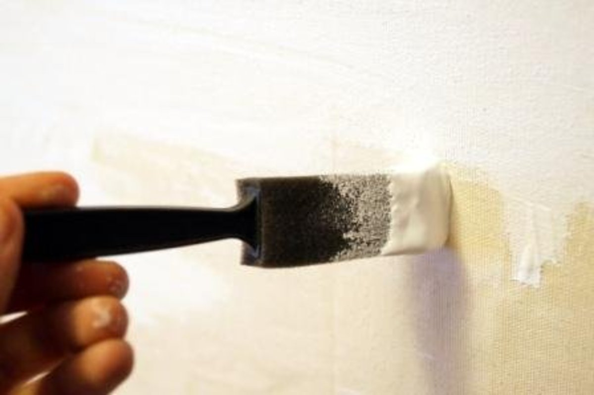 Though not the most environmentally friendly of choices, a foam brush works well to gesso a surface because you don't have to wash it; you can throw it away when finished.  If you leave any gesso on a paintbrush, it will ruin it.