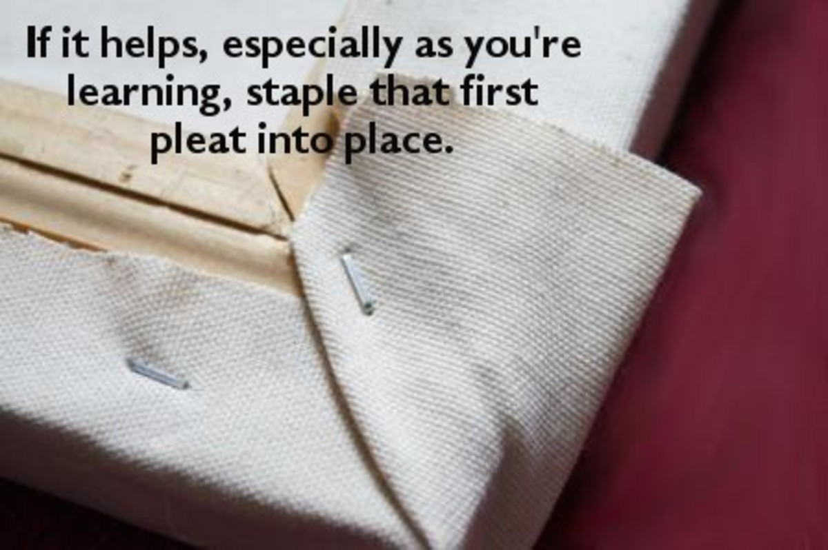 Staple the pleat into place if it helps.  That way you have something holding down the fabric when you're dealing with the final flap of canvas.