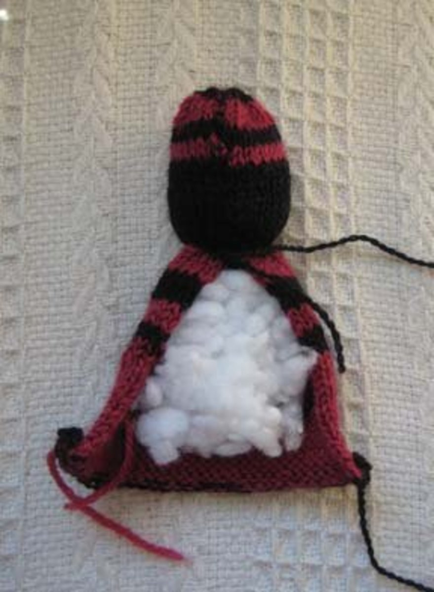 The Comfort Doll's head is stuffed and centre is sewn up. Then the body is stuffed.