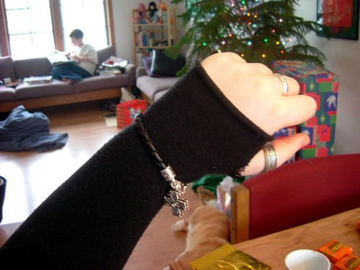 Basic garter stitch arm warmers—see how they curl at the hand?