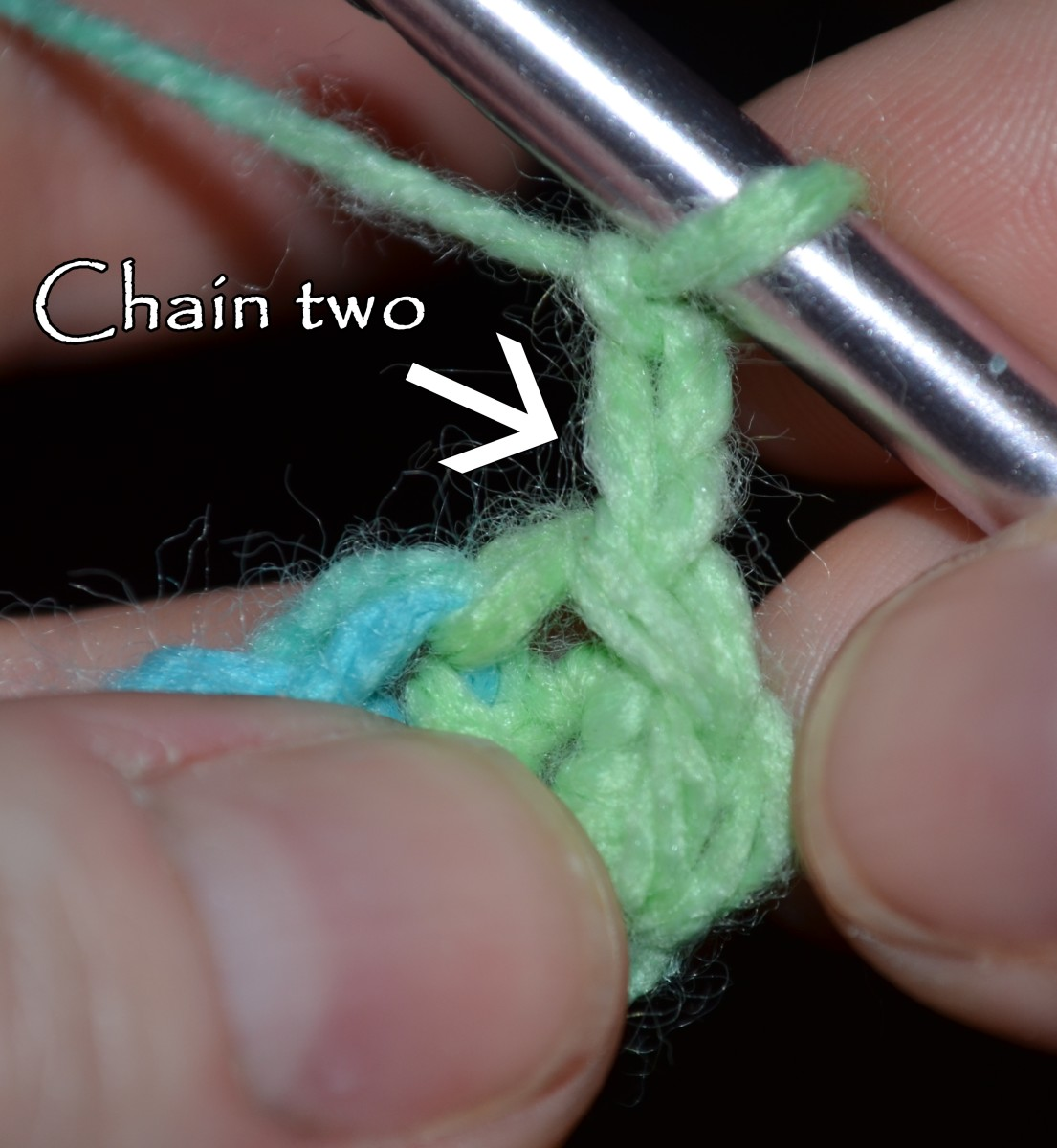 Chain two then complete a half double crochet in the same stitch (which is the slip stitch you made to finish the first round).