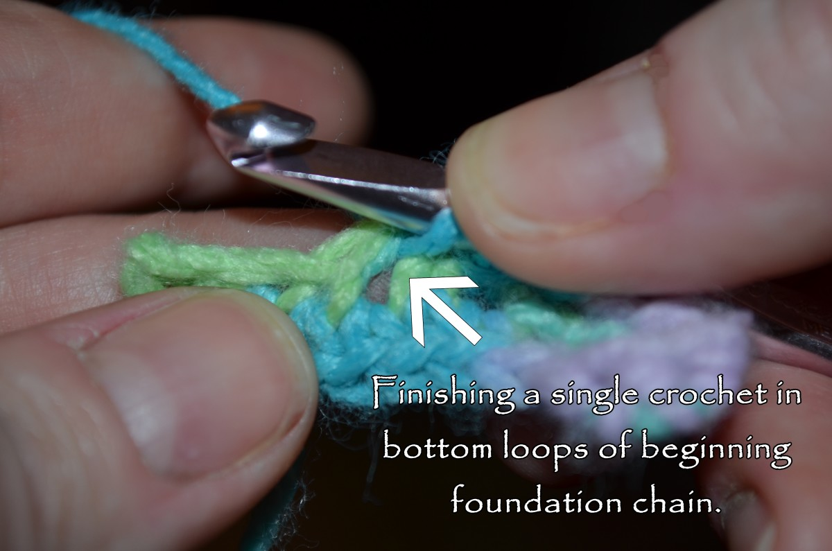 Finishing a single crochet in bottom loops of beginning foundation chain.