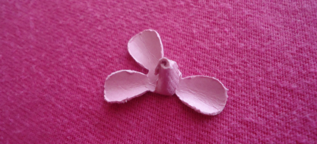 After you glue together the first 2 petals, it will look like this.