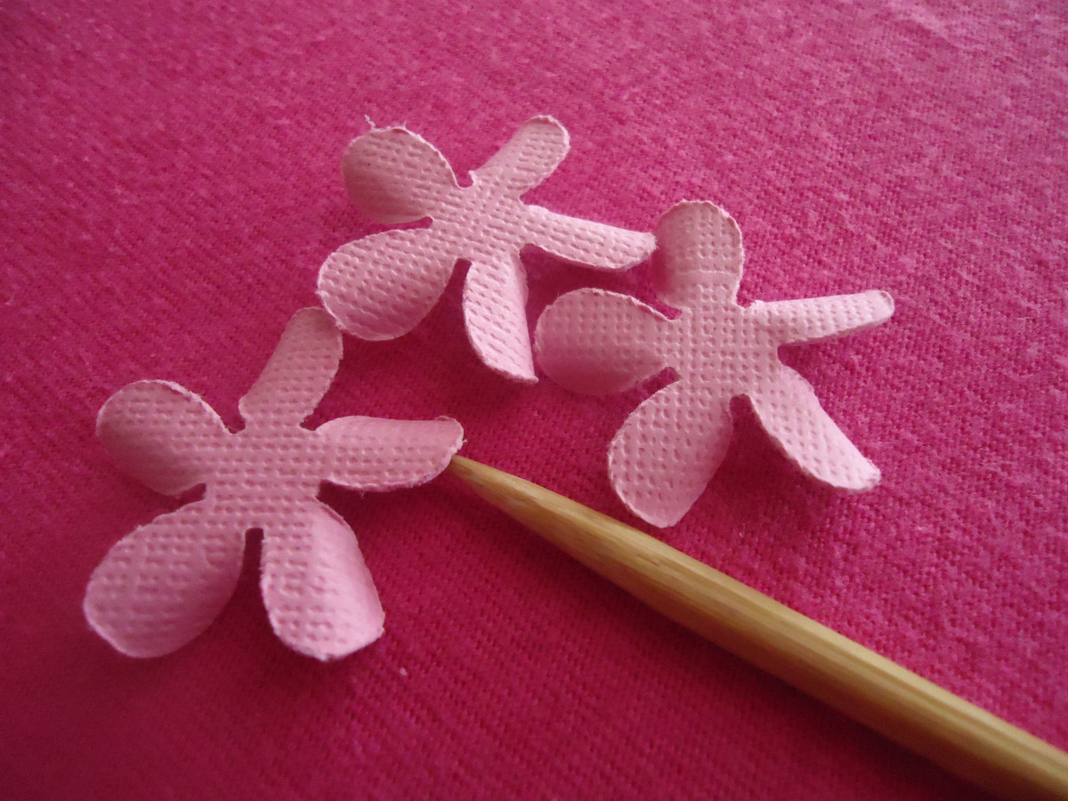 Now with the last remaining flower shapes, curl one side of each petal under with the skewer.