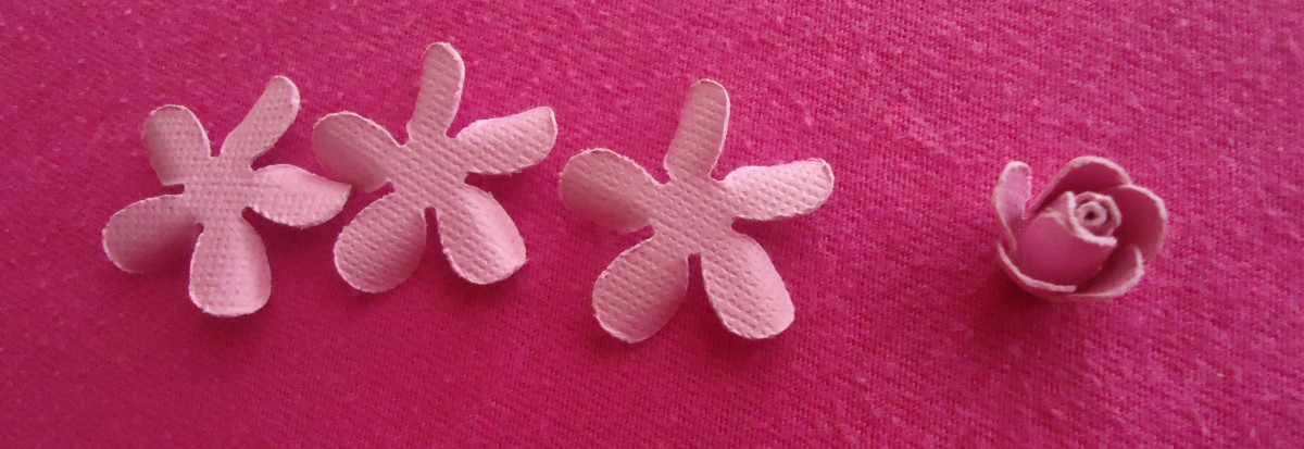 Now you have three left, take one and glue it (curled side of petals pointing down just like in photo) under the first 2.