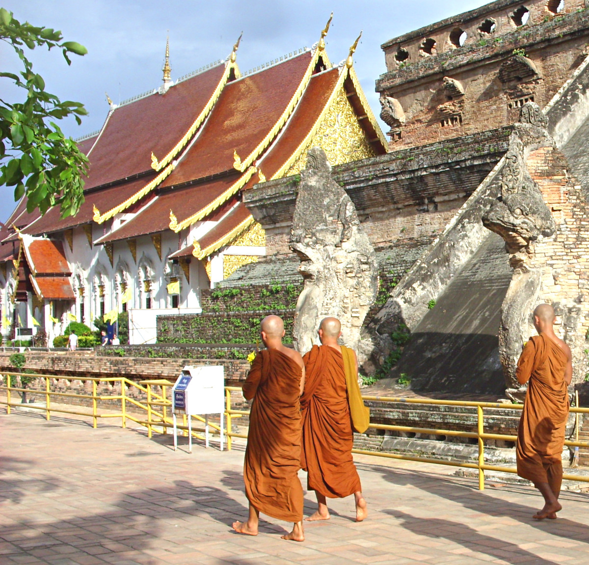 Buddhist monks at a Thai temple. Model release not required as the monks can't be identified from this shot.