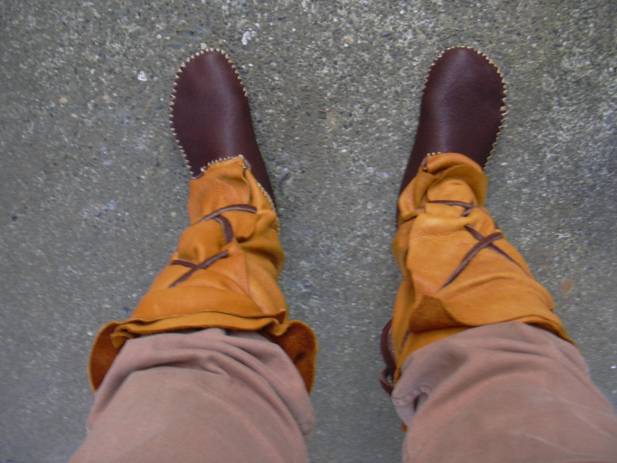 My latest pair of high top moccasins, before breaking in.  Buffalo brown on the vamp and sole and elk uppers, with buffalo lacing.