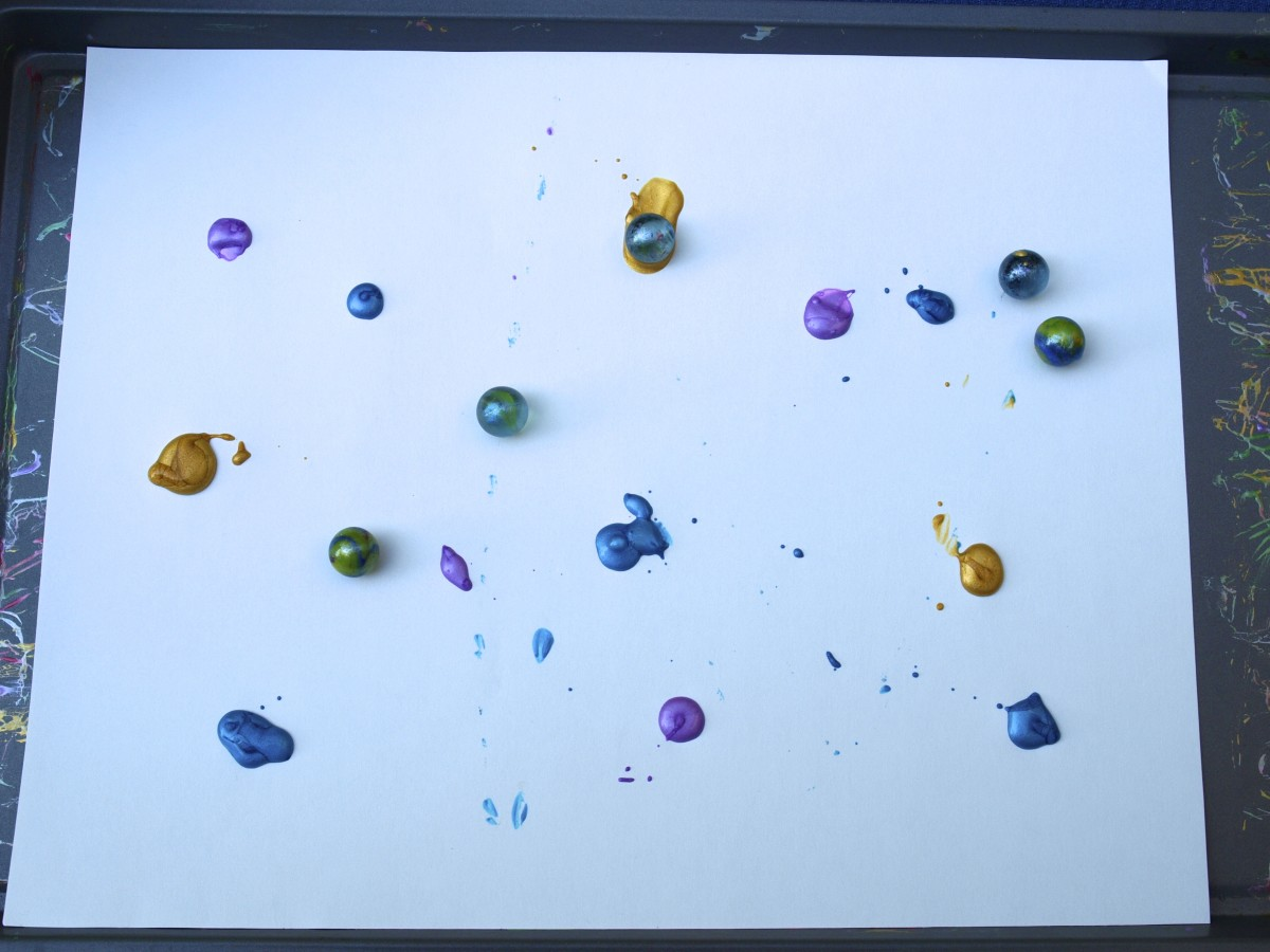 Place the marbles on the tray.