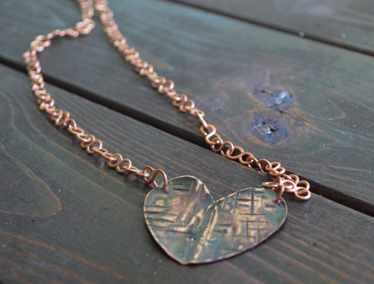 Metalwork heart necklace