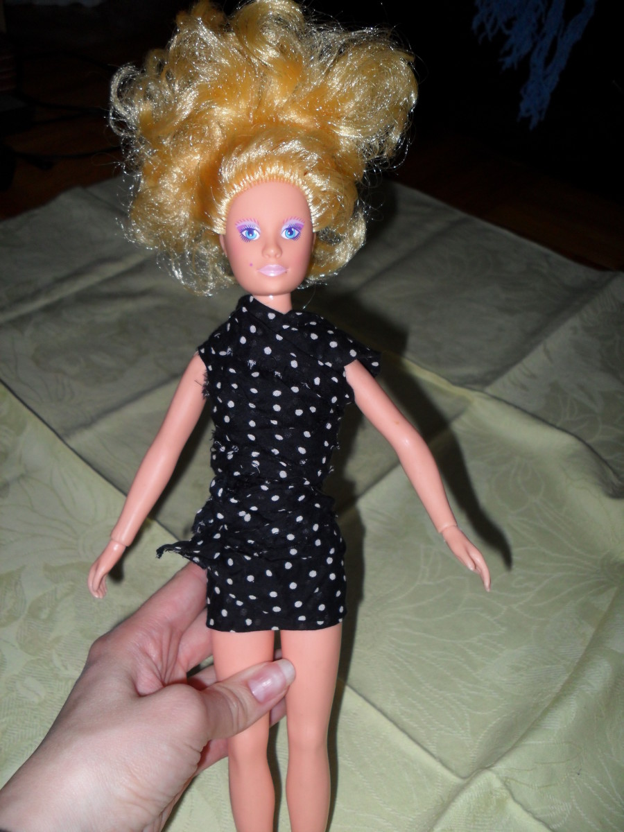 Ribbon and lace can be used to dress up your doll in a romper.