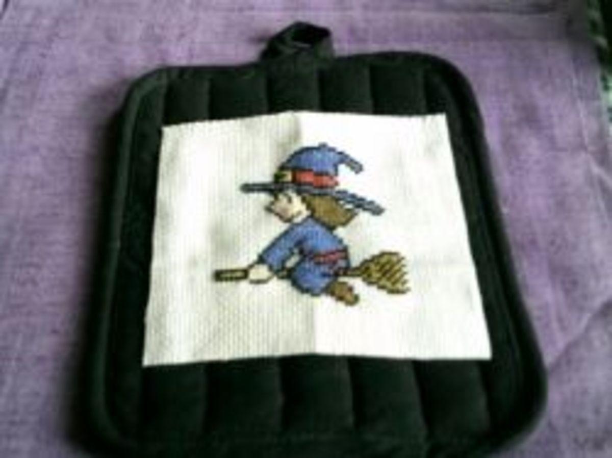 Cross-stitch applied to the potholder.