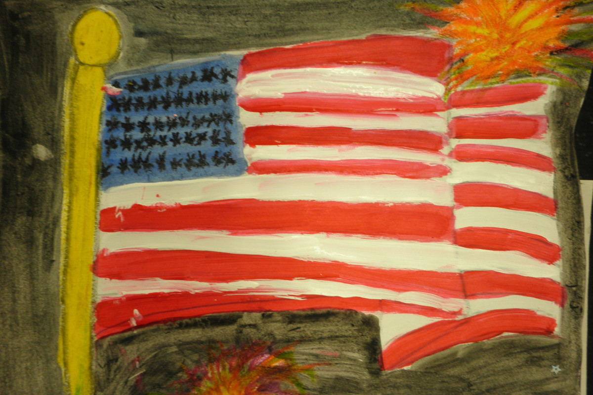 Painting of an American flag with acrylic paint with the fireworks done in oil pastels. Then a watercolor wash was added to the background. Very nice effect!