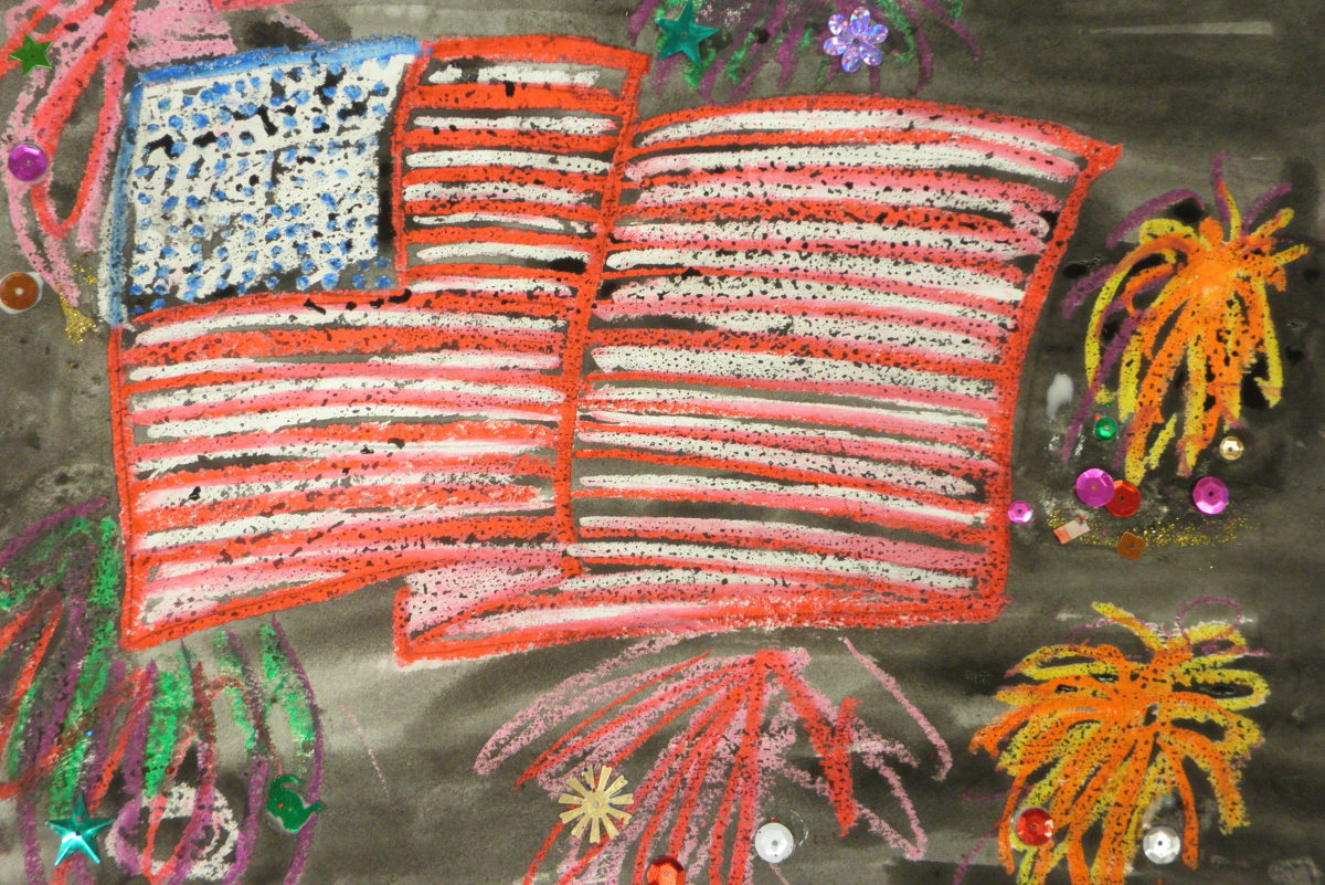 Painting of an American flag. In this one, the American flag and fireworks were done with oil pastels, then a watercolor wash was added for the background night sky. The optional sparkles were also added.