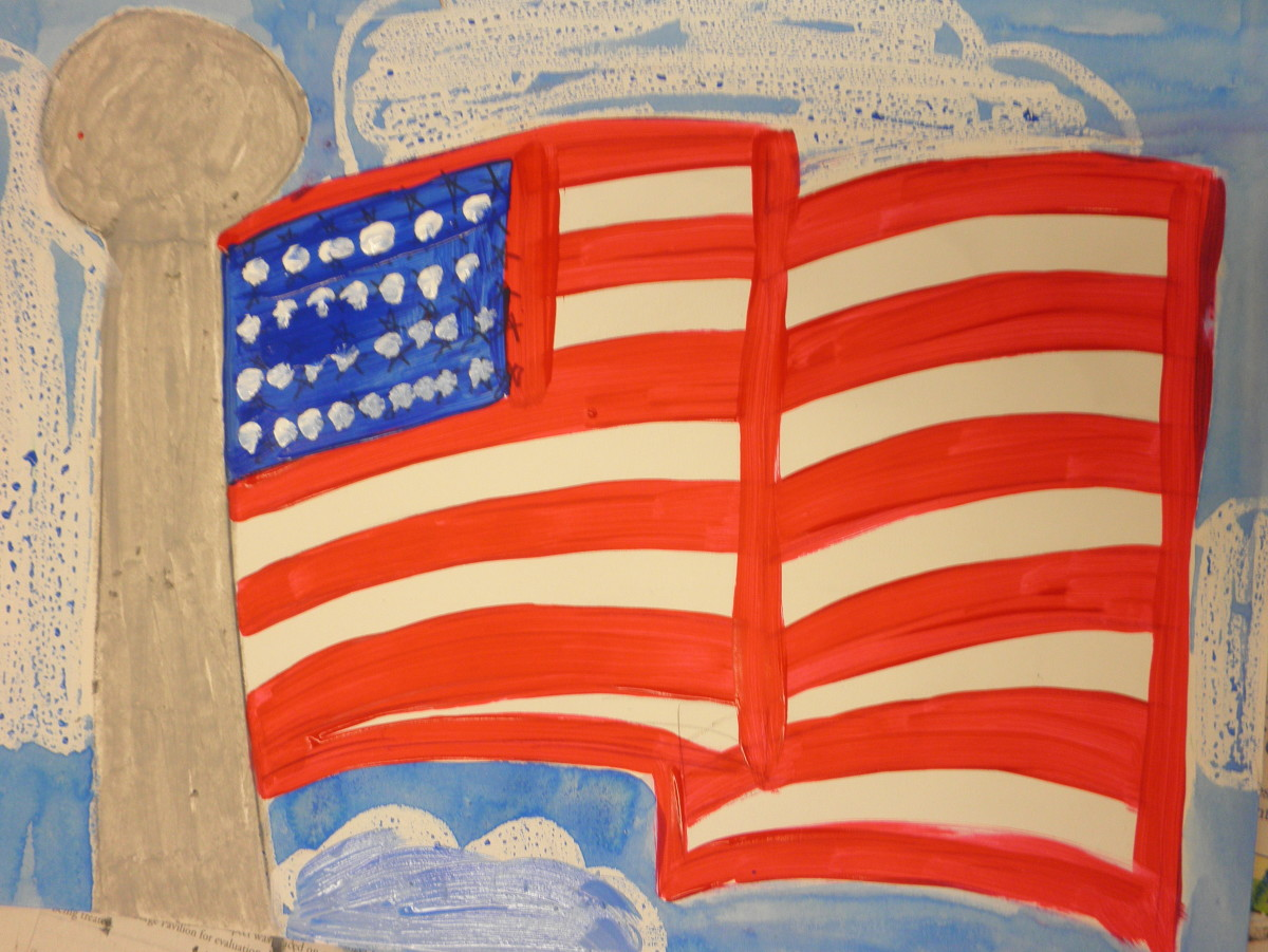 Painting of an American flag with acrylic paint. Charisse added clouds to her American flag painting. The clouds were done with oil pastel then a watercolor wash was added to the sky.  Beautiful job!