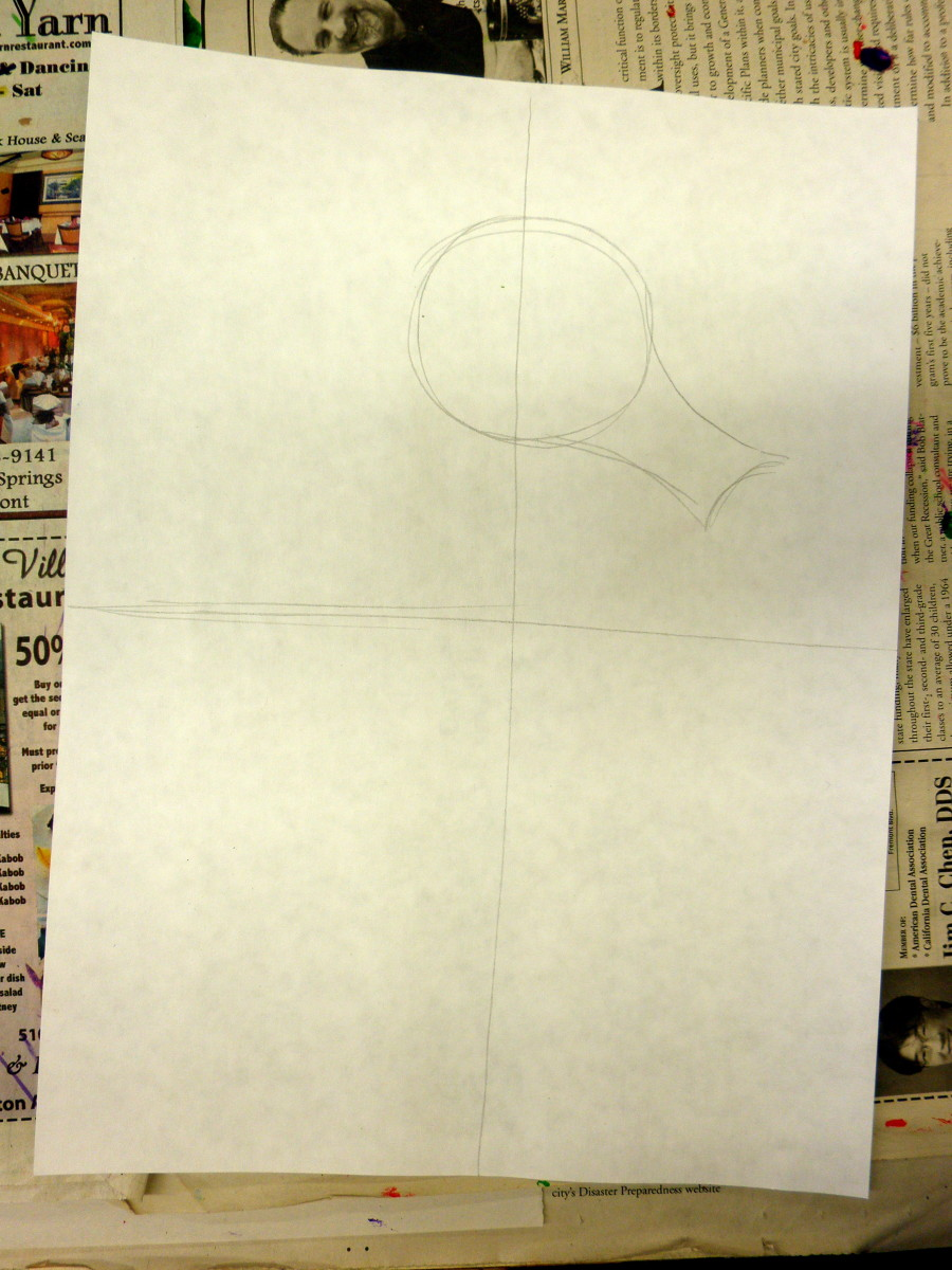 "In this first part of this art lesson draw your guideline like a cross. Make these light. Then draw a circle with a snout to begin your sea horse drawing. Notice where I placed the circle. Make sure your paper is ""portrait"" style."