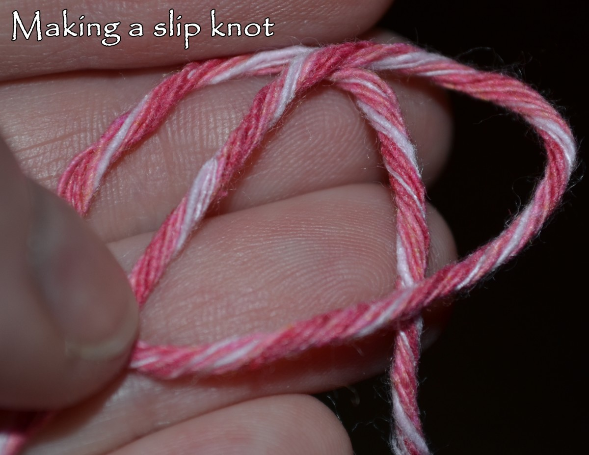 Prep the yarn like you're going to make a regular knot.