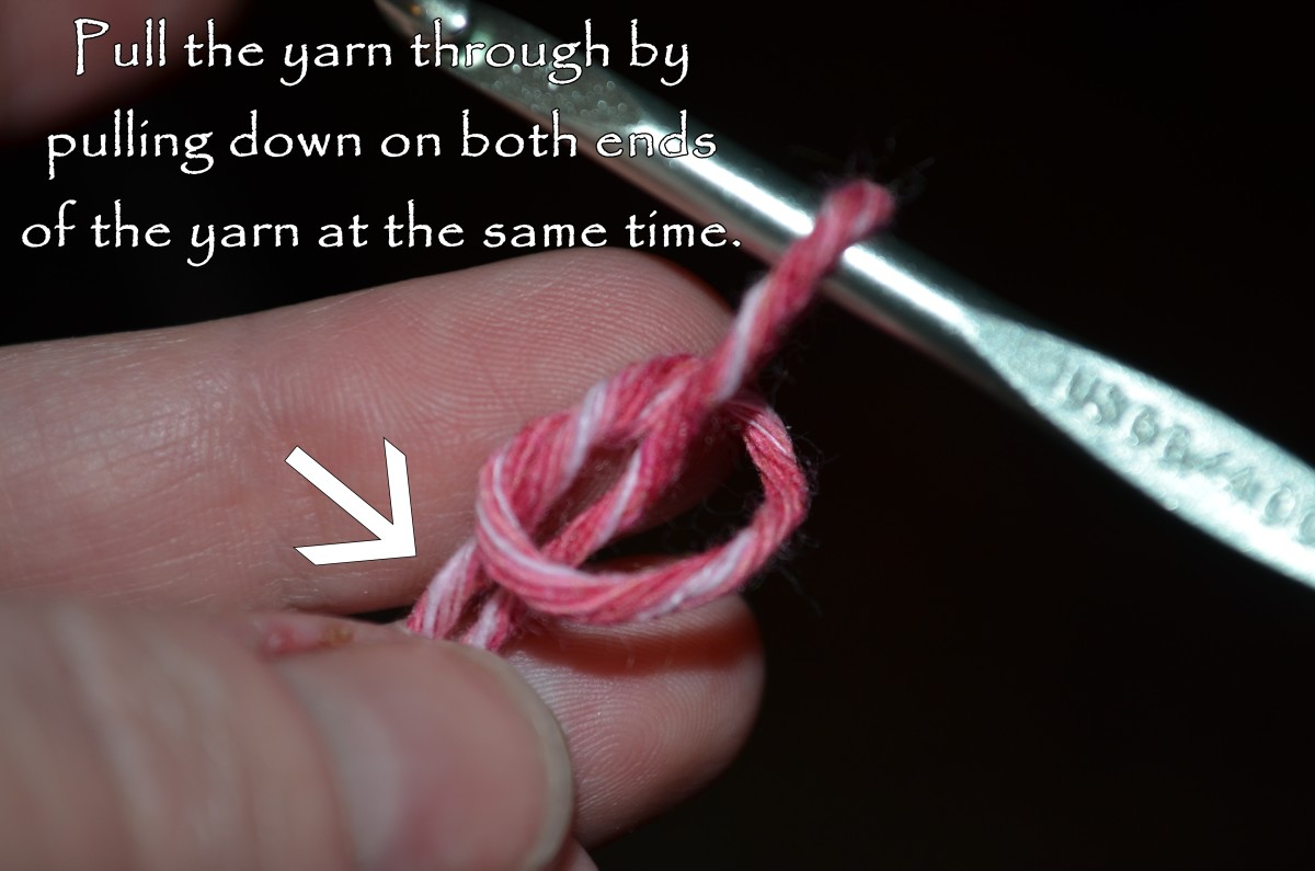 Pull down on both the long and short strands at the same time.