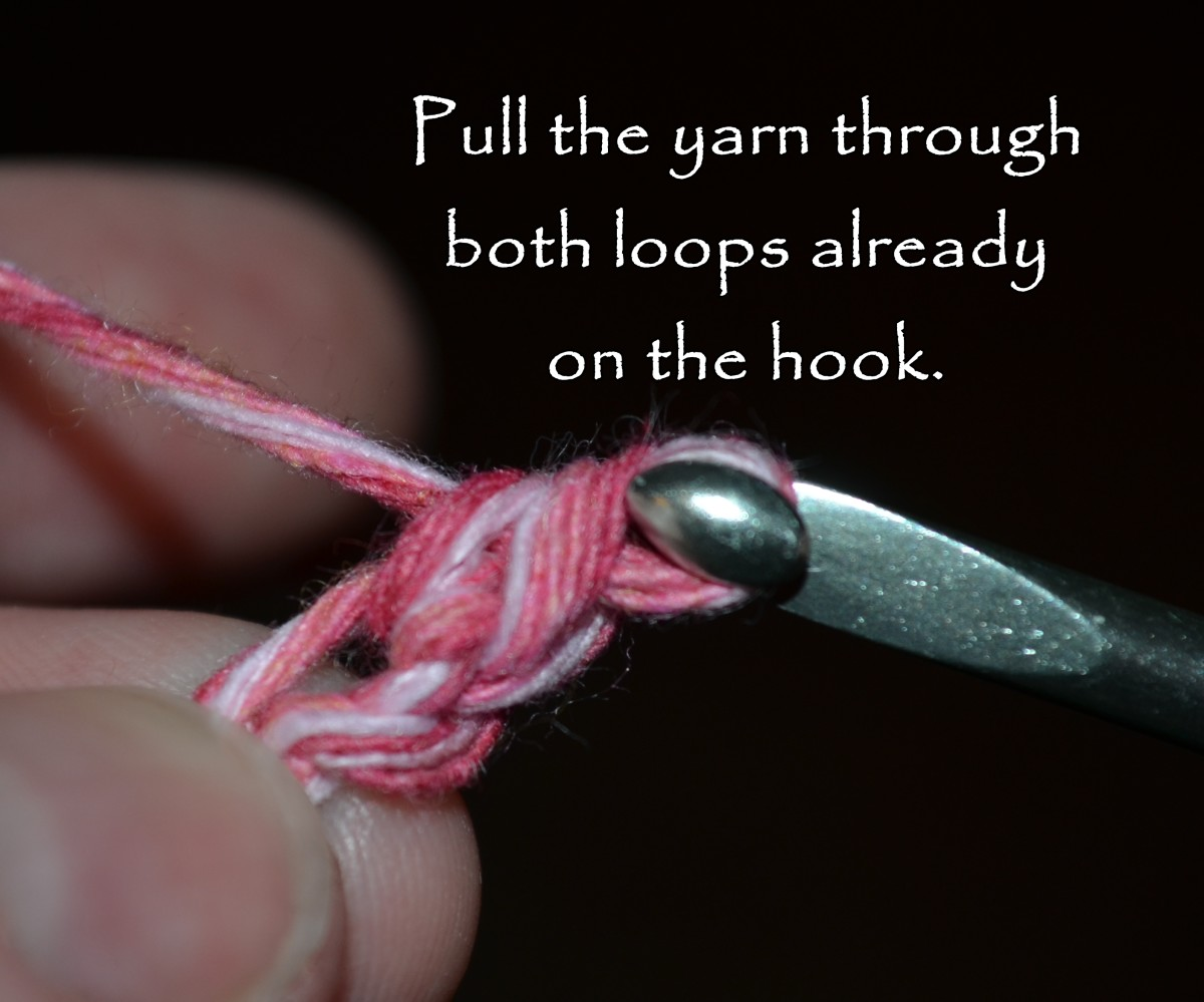 Pull the yarn through both loops already on the hook.