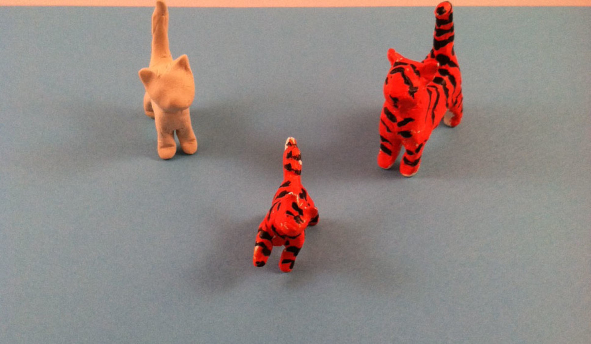 Miniature cats made from Crayola Air-Dry Clay