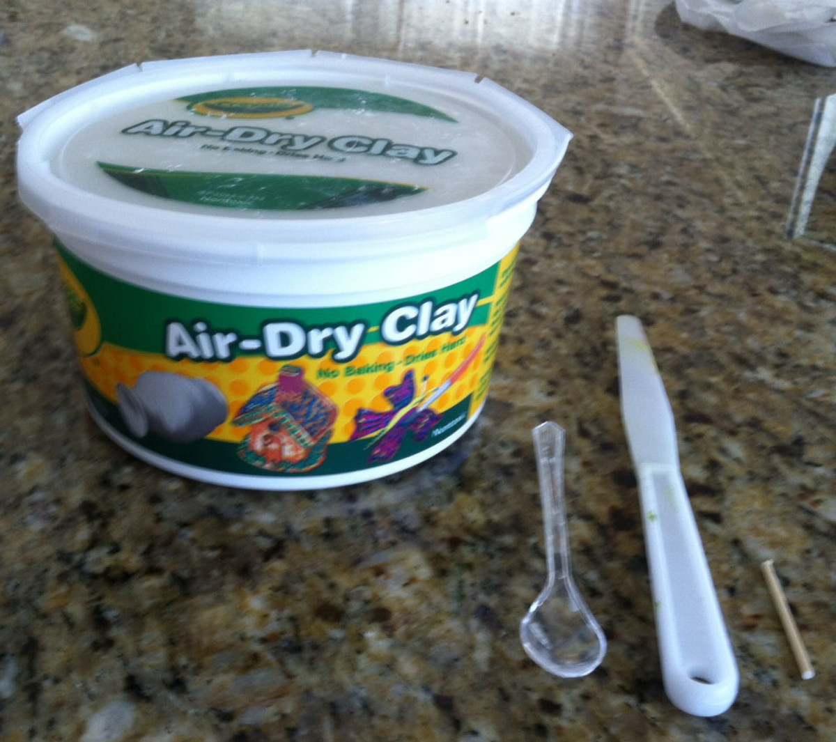 Crayola brand air-dry clay, miniature spoon, plastic palette knife and a miniature dowel. Not pictured but used: toothpicks, wipes, water, paints, brushes.